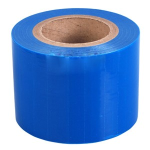 Adhesive edges blue barrier film with dispenser